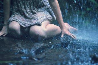 weeping girl in the rain